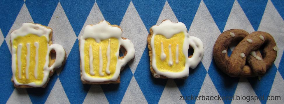 drei Kekse verziert als bierkrüge, eine schoko-mürbteigbreze mit hagelzucker