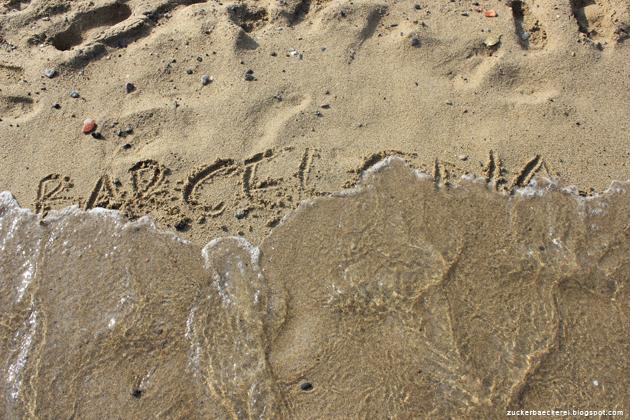 barcelona in den sand geschrieben